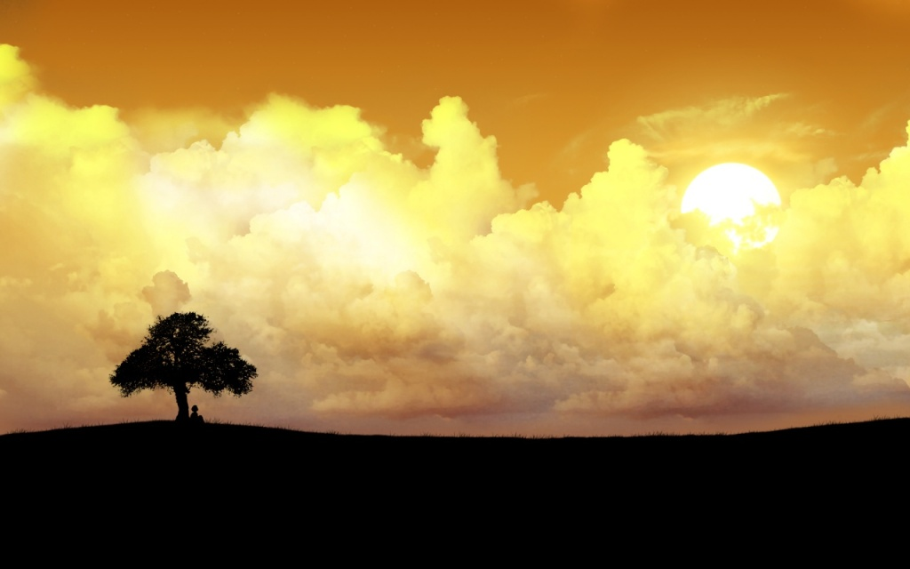 A photo of some beautiful cumulus clouds at sunset with one tree and a man sitting under the tree.