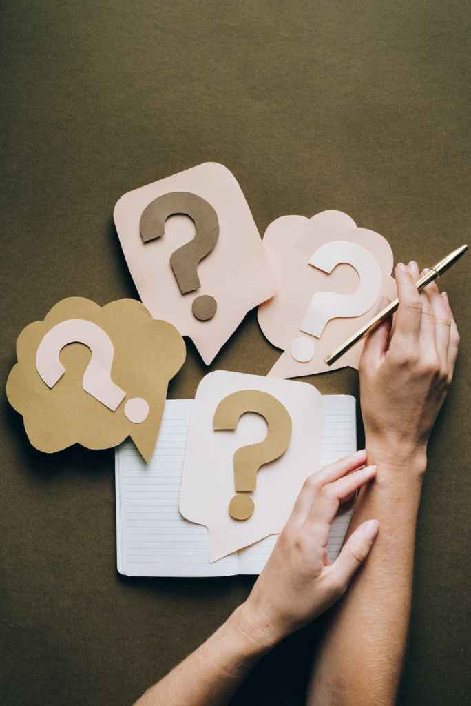 A photo of question marks made out of paper.